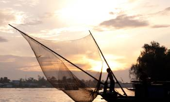 Fishing at dusk on the Mekong River