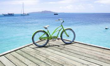 a bicycle next to a body of water
