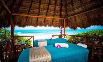 a bed with a blue umbrella