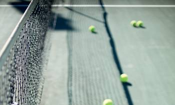 a person hitting a ball with a racket on a court