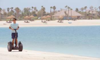 a man riding a motorcycle on a beach