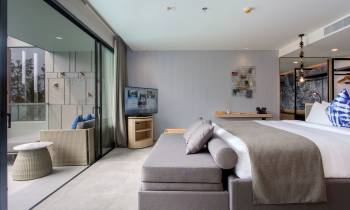 a bedroom with a view of a living room