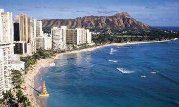 a large body of water with Diamond Head in the background
