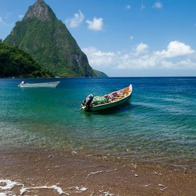 a boat on a beach near a body of water