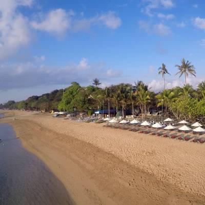 a row of cars on a sandy beach