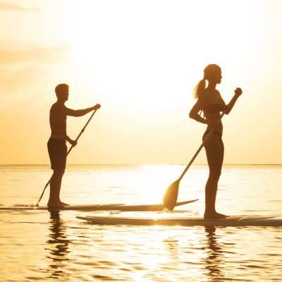 Couple paddleboarding
