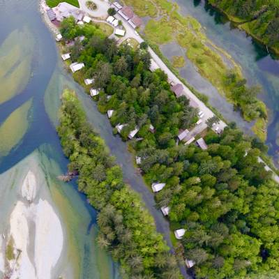 Aerial View of Riverfront Tents