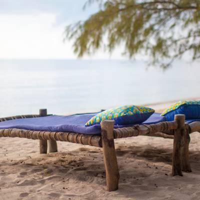 a wooden bench sitting next to a body of water