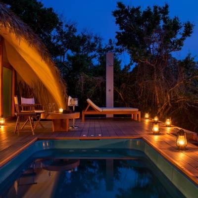Private pool cabin night view, Chena Huts