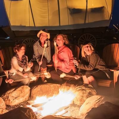 Campfire with s'mores at Conestoga Ranch Glamping Resort