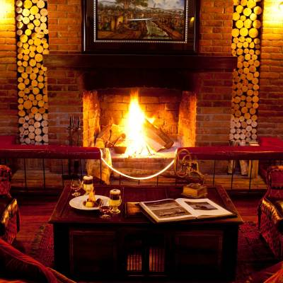 a fire place and a glass of wine