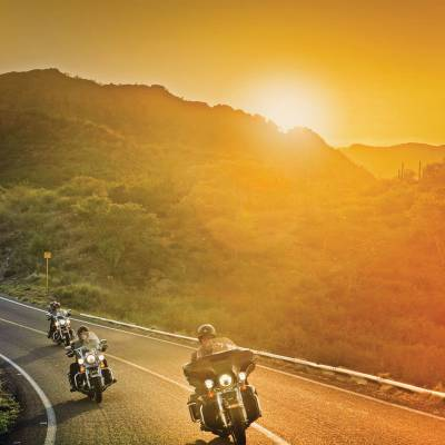 Motorcycle ride at sunset