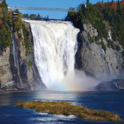 a large waterfall over some water with Montmorency Falls in the background