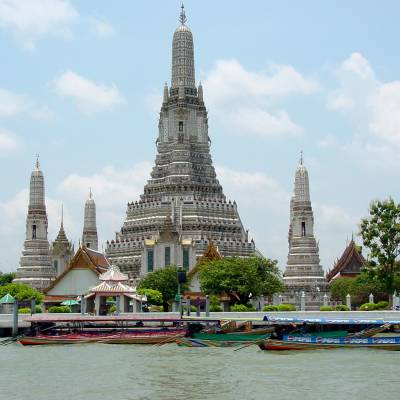 a large body of water in front of Wat Arun