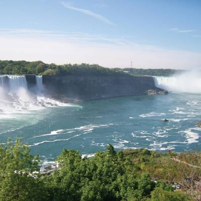 a large body of water with Niagara Falls in the background