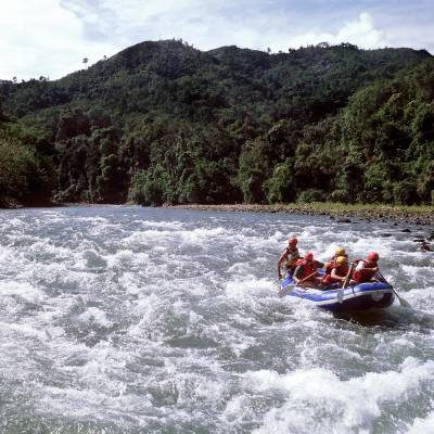 a group of people riding skis on a raft in a body of water