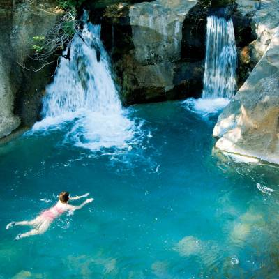 a large waterfall and a pool of water