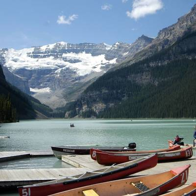 a boat that is sitting on the side of Lake Louise