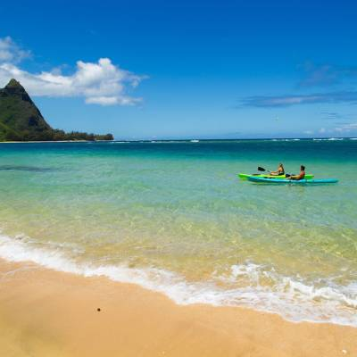 Couple kayaking at Makua beach