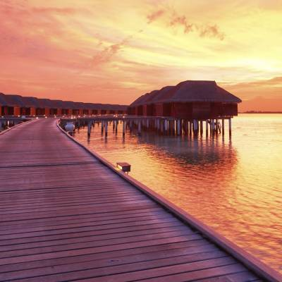 Maldivian Water Villa at Sunset