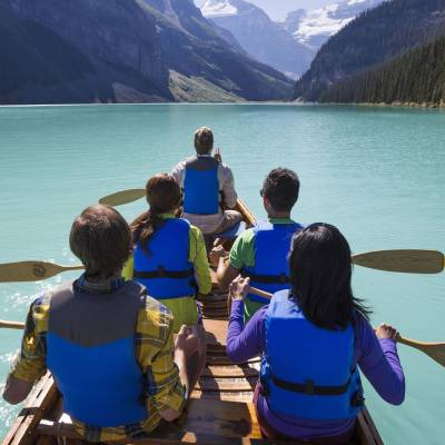a group of people sitting in front of a body of water