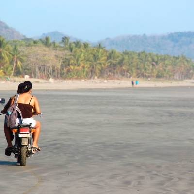 a man riding on the back of a motorcycle