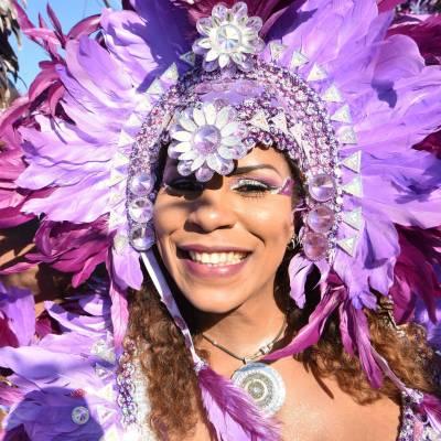 a person wearing a purple flower