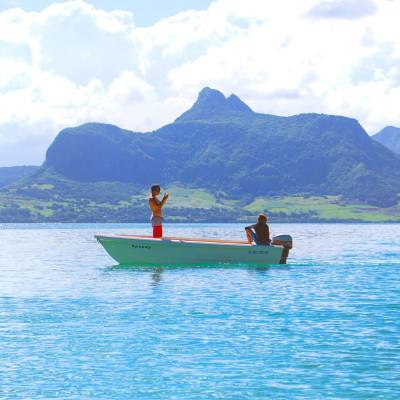 Speedboat in Mauritius with the island in the background