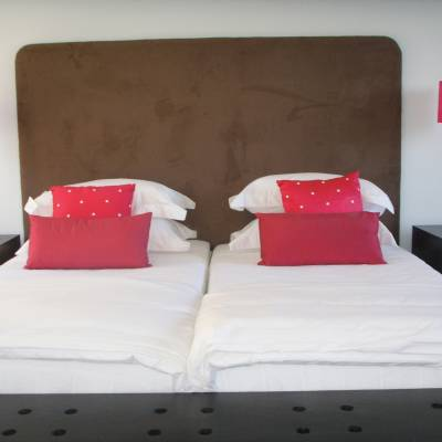 a large red bed in a room