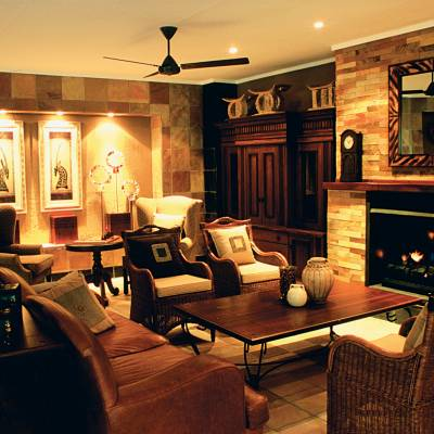 a living room filled with furniture and a fire place