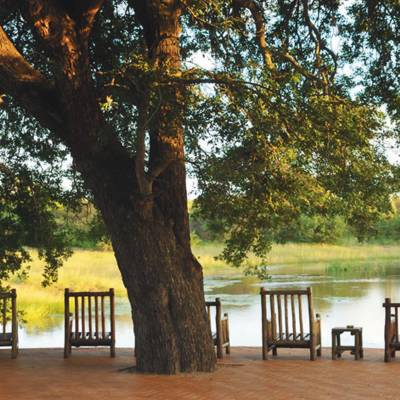 an empty park bench next to a body of water