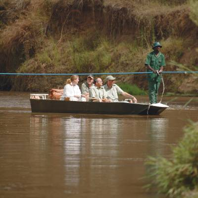 a group of people in a boat on a body of water