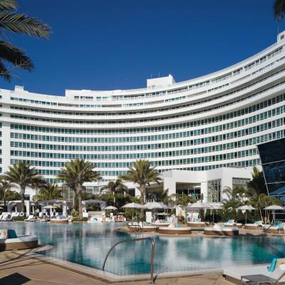 a large pool of water in front of Fontainebleau Miami Beach