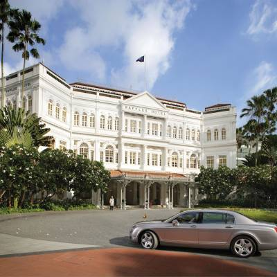 a car parked in front of Raffles Hotel