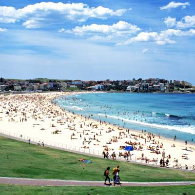 a group of people on a beach with Bondi Beach in the background