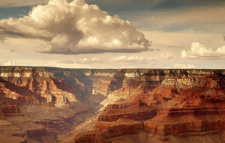 a group of clouds in a canyon