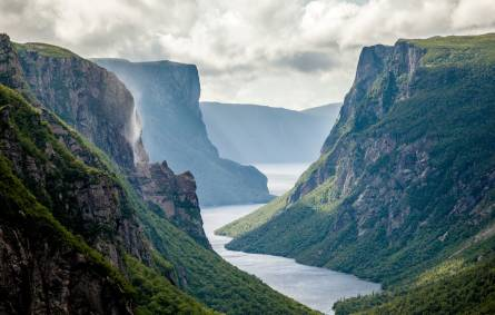 a canyon with Gros Morne National Park in the background