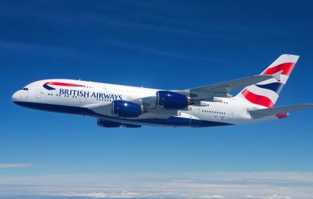 a large passenger jet flying through a blue sky