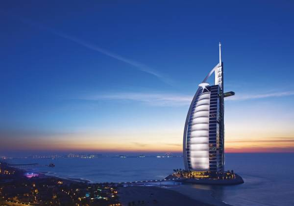 a large body of water with Burj Al Arab in the background