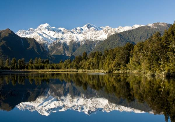 Lake Matheson with a mountain in the background