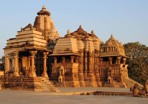 a group of people in front of Khajuraho Group of Monuments