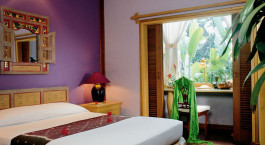 Schlafzimmer im Tugu Malang Hotel in Malang, Indonesien