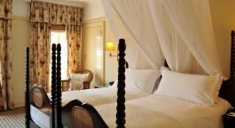 Schlafzimmer im Victoria Falls Hotel, Victoria Falls, Simbabwe