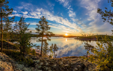 Republic of Karelia. Islands. Northern nature. The sun above the water.