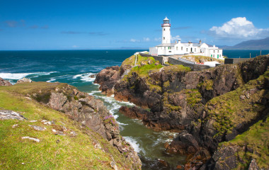 Lighthouse on peninsula Fanad which lies between Lough Swilly and Mulroy Bay on the north coast of County Donegal in Ireland