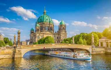 Historic Berlin Cathedral at famous Museumsinsel with excursion boat on Spree river, Berlin, Germany, Europe
