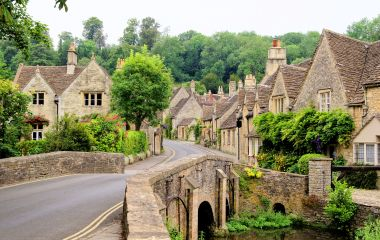 Quaint Castle Combe village with its characteristic bridge in the Cotswolds, UK