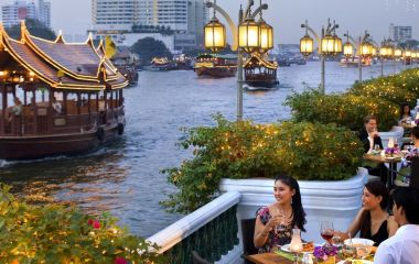 Girls having food near river, Bangkok, Thailand, Southeast Asia
