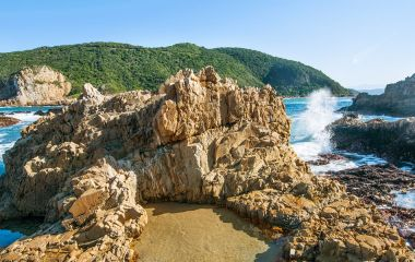 Knysna heads sunset, rocks shore, Indian Ocean, Garden Route, South Africa