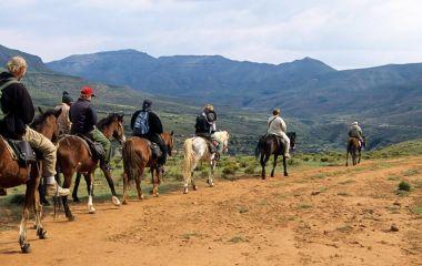 People trekking in horse, Western Lesotho, Africa